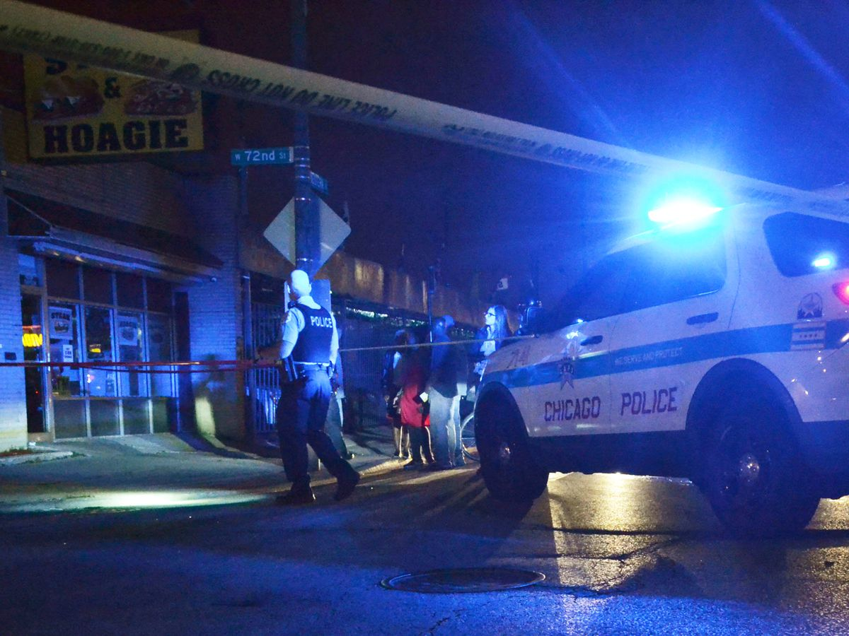 Police investigate a shooting early Saturday in the Marquette Park neighborhood.   Justin Jackson/Sun-Times