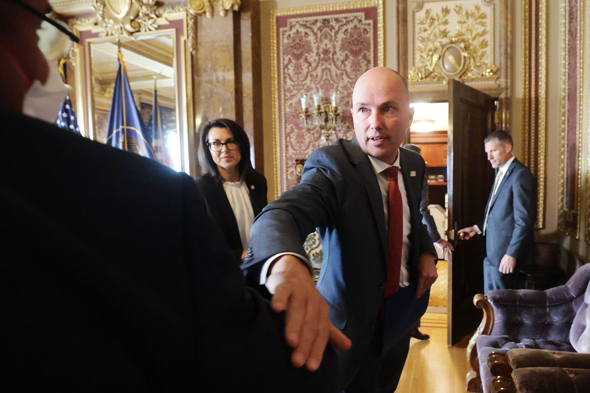 Gov. Spencer Cox elbow-bumps Marc Harrison, CEO of Intermountain Healthcare, after a COVID-19 briefing in Salt Lake City.