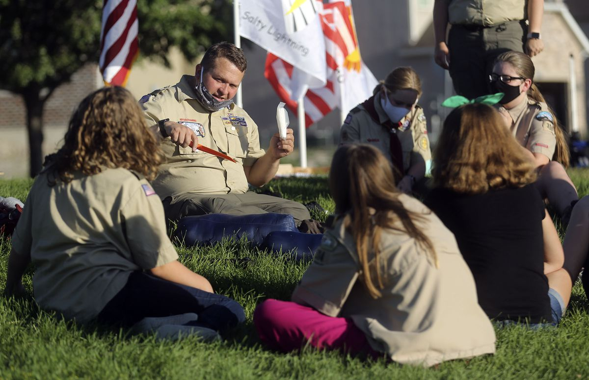Scoutmaster Thomas Carlisle demonstrates how to bury your poop while camping during a Boy Scout meeting for the all-female Troop 7314 at Parkview Park in Stansbury Park on Monday, July 6, 2020.