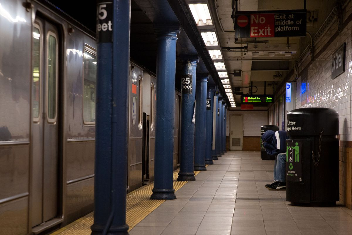 A person finds refuge at a Harlem subway station during the coronavirus outbreak, May 12, 2020.