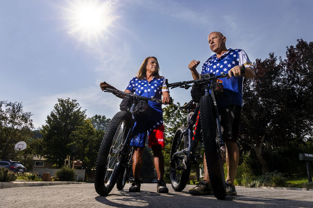 Lorri, left and Dean Zenoni pose for a photo on a street near their home in Sandy, Utah.