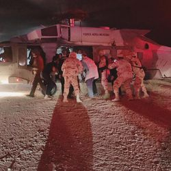 In this photo provided by the Sonora state Health Secretary, children of the extended LeBaron family, who were injured in an ambush, are taken aboard a Mexican Airforce helicopter to be flown to the Mexico-U.S. border, from the border between the Mexican states of Chihuahua and Sonora, on Monday, Nov.4, 2019. The children were injured when drug cartel gunmen ambushed three SUVs along a dirt road, slaughtering six children and three women, all U.S. citizens living in northern Mexico, in a grisly attack that left one vehicle a burned-out, bullet-riddled hulk.