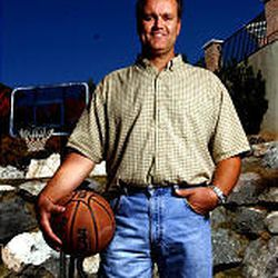 Announcer Craig Bolerjack has a basketball court in his back yard in Sandy.