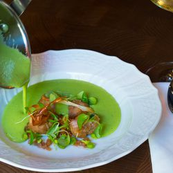 The soup is served table side to insure that the sweetbreads are crispy.