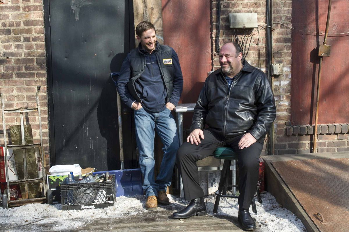 Tom Hardy (left) and James Gandolfini play bar employees who get in over their heads in The Drop.