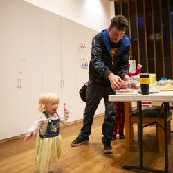 Julianna Branstetter, 1, walks around a community room as father Matthew prepares some donated food for dinner at Lake Washington United Methodist Church in Kirkland, Wash., on Sunday, Oct. 13, 2019. The family has been using the Safe Parking program for the past several months, first becoming homeless in December 2018.