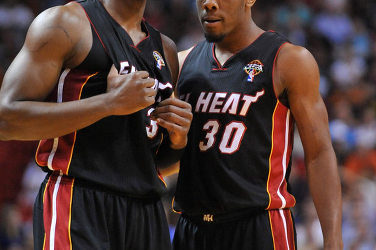 March 20, 2012; Miami, FL, USA; Miami Heat shooting guard Dwyane Wade (left) talks with point guard Norris Cole (right) during the second half against the Phoenix Suns at American Airlines Arena. Mandatory Credit: Steve Mitchell-US PRESSWIRE