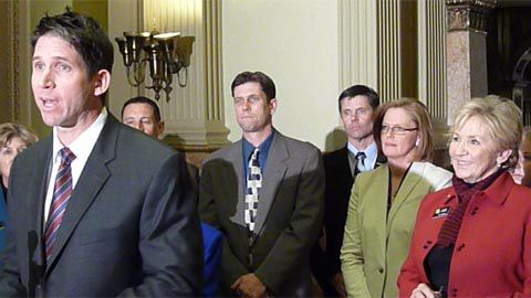 Kellli Jantz (wearing glasses at right) and Sen. Nancy Spence (red jacket) listen to former Bronco Ed McCaffrey urge adoption of the concussion bill.
