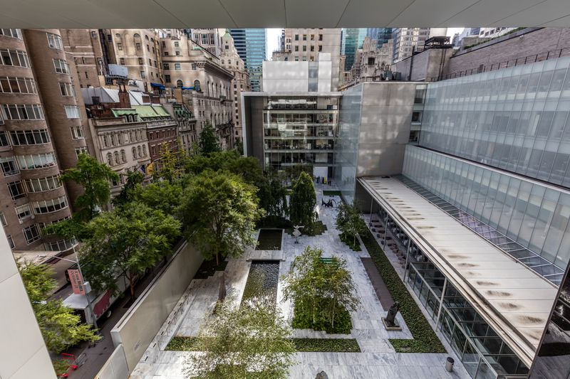 An aerial view of a sculpture garden with trees.