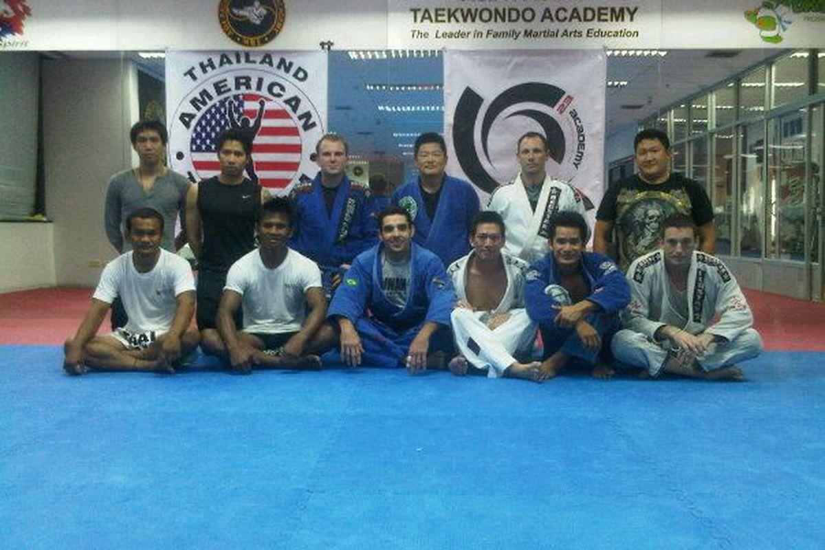 Buakaw (seated, 2nd from left) trains jiu jitsu in Bangkok.
