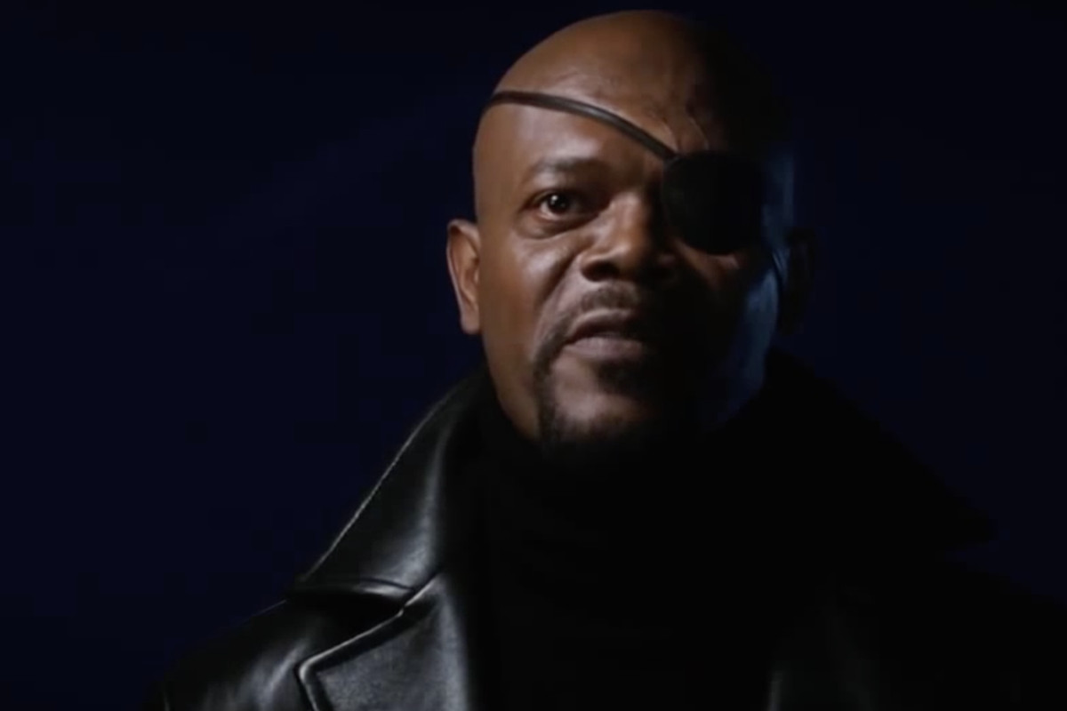 nick fury stares at the camera, his face in shadow