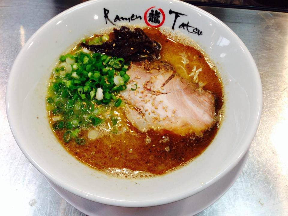 Bowl of ramen inscribed with restaurant name