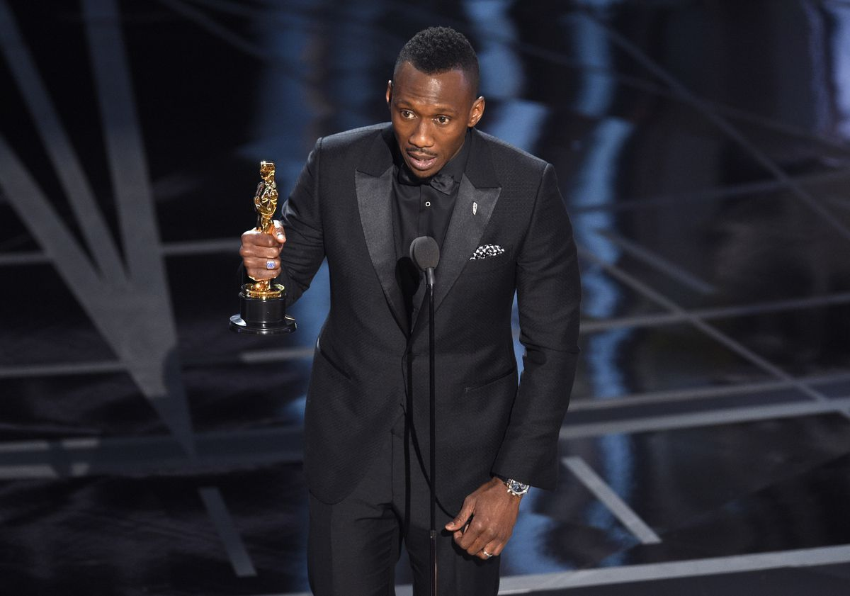 """Mahershala Ali accepts the award for best actor in a supporting role for """"Moonlight"""" at the Oscars on Sunday. 