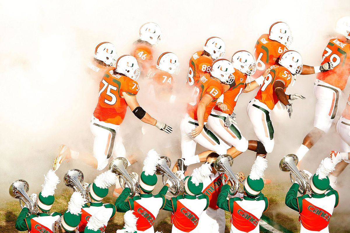 MIAMI GARDENS, FL - NOVEMBER 25:  The Miami Hurricanes take the field during a game against the Boston College Eagles at Sun Life Stadium on November 25, 2011 in Miami Gardens, Florida.  (Photo by Mike Ehrmann/Getty Images)