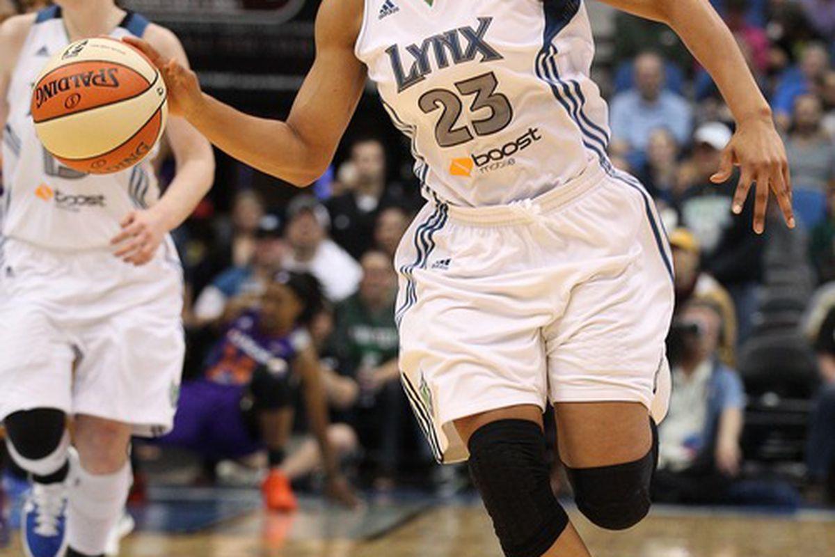 May 20, 2012; Minneapolis, MN, USA: Minnesota Lynx forward Maya Moore (23) dribbles down the court in the second half against the Phoenix Mercury at Target Center. The Lynx won 105-83. Mandatory Credit: Jesse Johnson-US PRESSWIRE