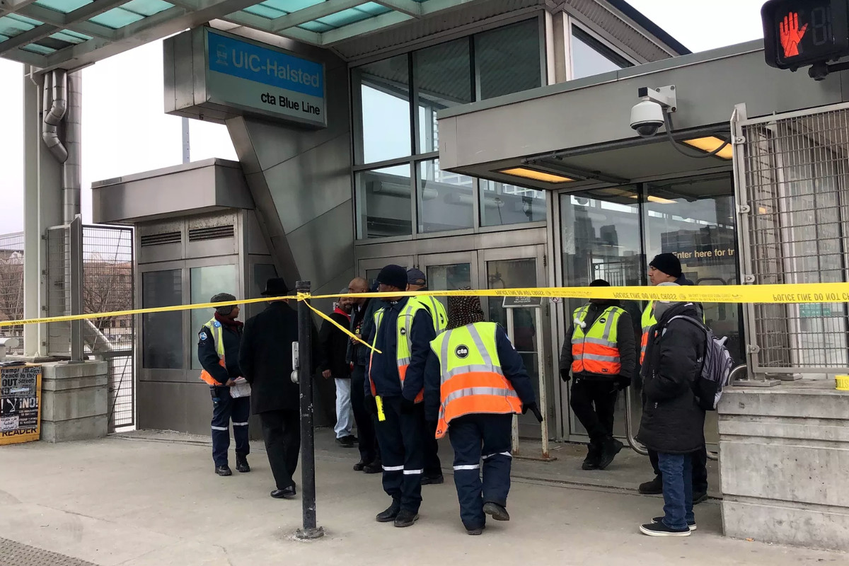 CTA personnel gather outside the Blue Line station at UIC-Halsted, 430 S. Halsted St., where a man was shot on a train Monday.