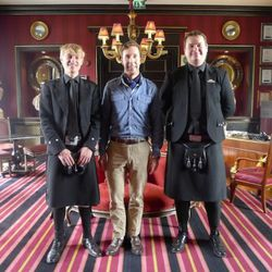 Greeted by lads in black kilts at Prestonfield House.