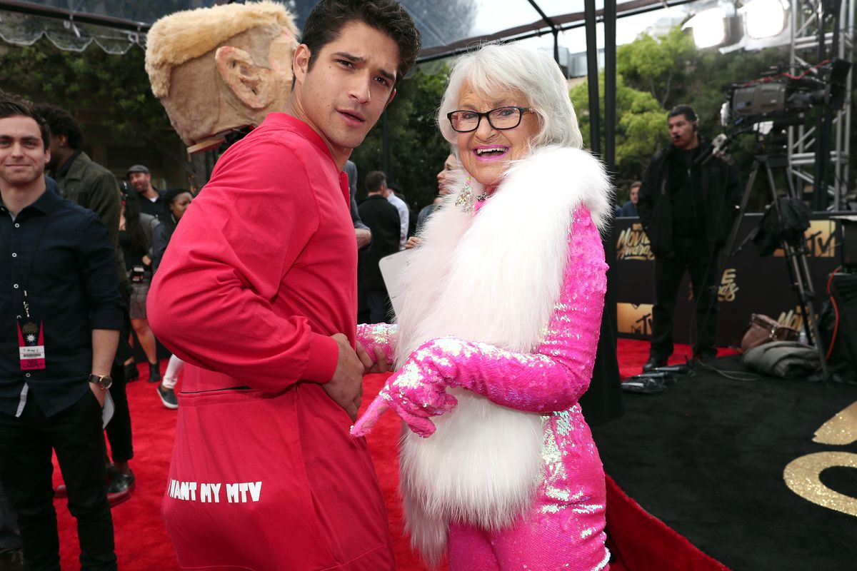 Tyler Posey (left) and Baddie Winkle on the red carpet at the 2016 MTV Movie Awards.