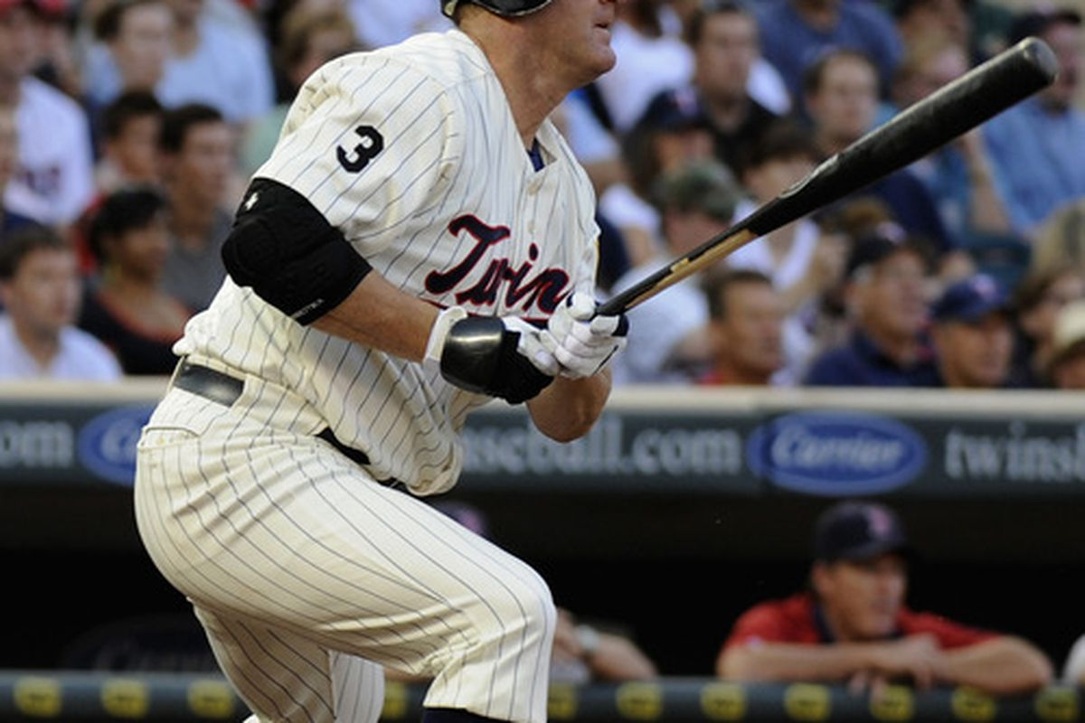 MINNEAPOLIS, MN - AUGUST 10: Jim Thome #25 of the Minnesota Twins hits an RBI single against the Boston Red Sox in the first inning on August 10, 2011 at Target Field in Minneapolis, Minnesota. (Photo by Hannah Foslien/Getty Images)