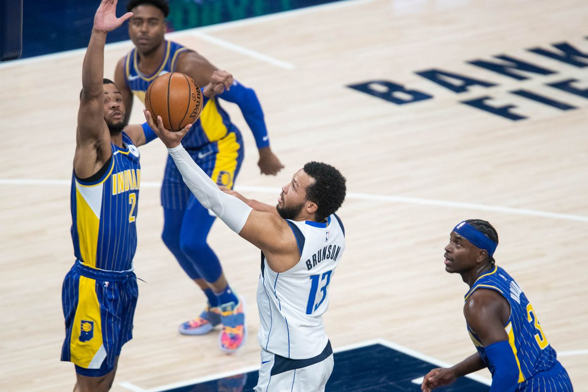 Dallas Mavericks guard Jalen Brunson (13) shoots the ball while Indiana Pacers guard Cassius Stanley (2) defends in the fourth quarter at Bankers Life Fieldhouse.
