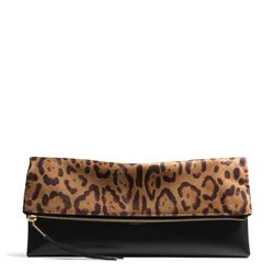 """<a href=""""http://f.curbed.cc/f/Coach_SP_102413_Leopardclutch"""">Large clutchable</a> in leopard, $798"""