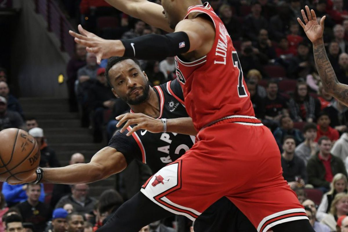 eddd545c53b Toronto Raptors' Norman Powell, left, passes the ball around Bulls' Timothe  Luwawu-Cabarrot in the first half of the Raptors' 124-101 victory Saturday  night ...