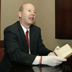 Richard E. Turley Jr., assistant church historian and recorder holds the old Book of Mormon owned by Hyrum Smith, Tuesday, Oct. 6, 2009, in Salt Lake City.