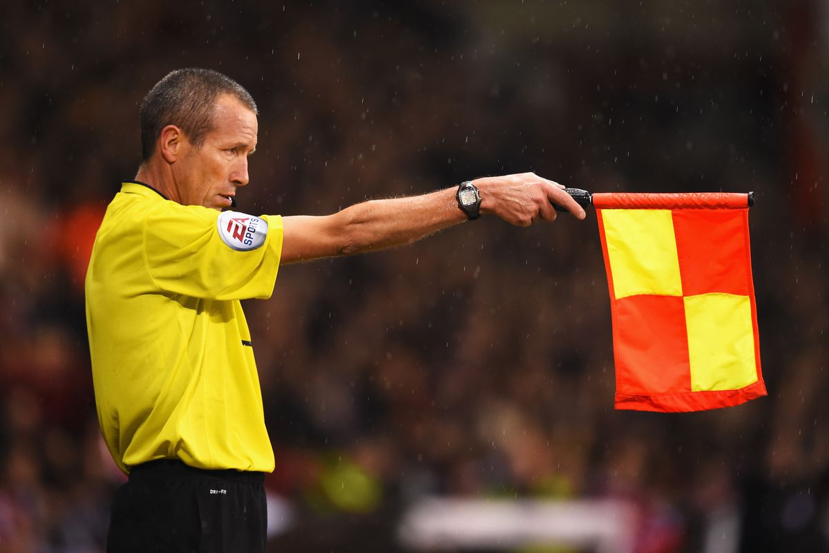 This is an image of an assistant referee holding aloft a flag to indicate an offside decision. This is included for no apparent reason other than it was thought that it would look quite nice.