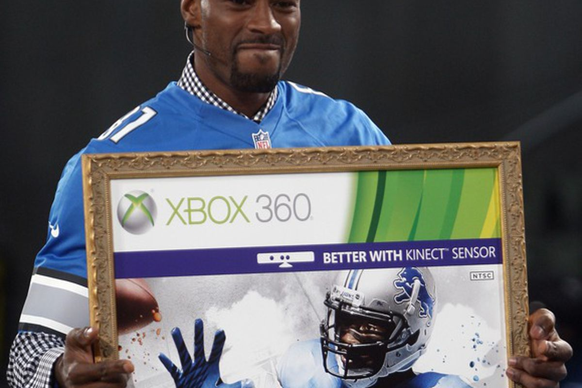 Apr 25, 2012; New York, NY, USA; Detroit Lions receiver Calvin Johnson holds up a poster after being named the cover athlete during the Madden 13 cover unveiling on the set of SportsNation at Times Square.  Mandatory Credit: Jerry Lai-US PRESSWIRE