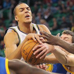 Utah's Rudy Gobert is fouled by Ognjen Kuzmic as the Utah Jazz and the Golden State Warriors play Tuesday, Oct. 8, 2013 in preseason action at Energy Solutions arena in Salt Lake City.