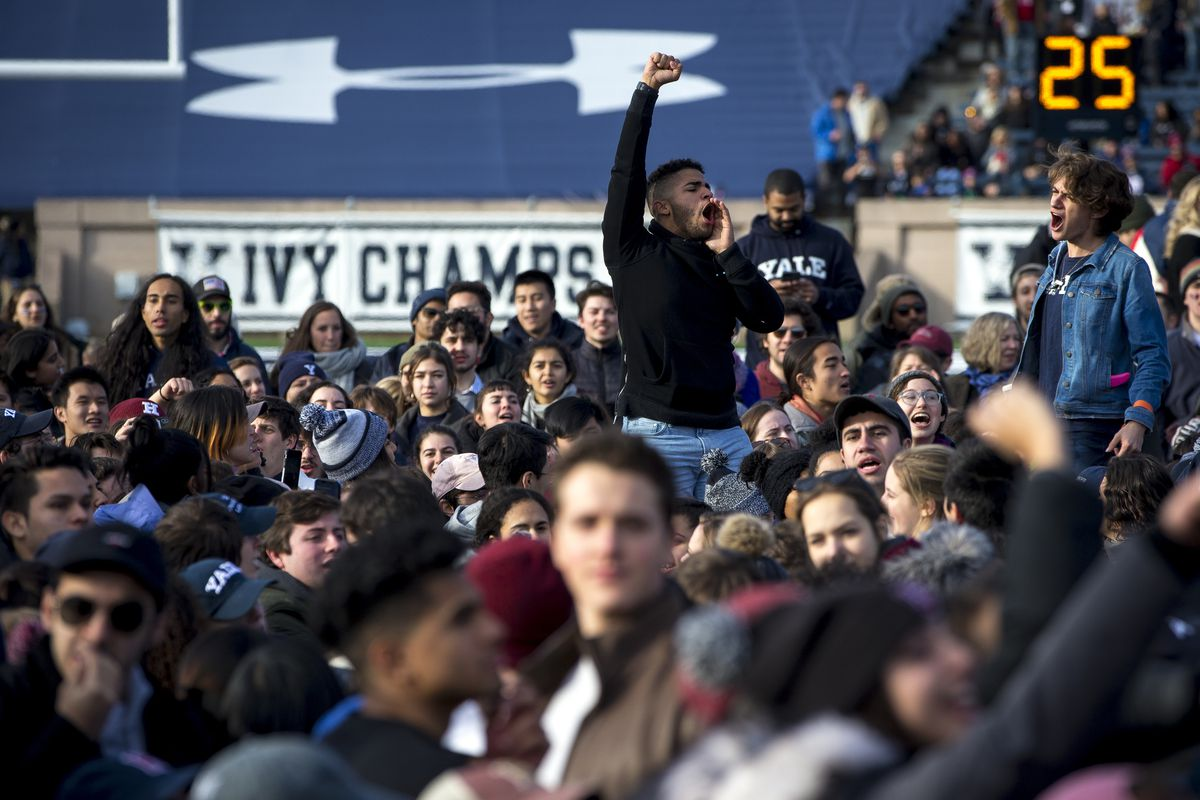 Harvard and Yale Students Protest for Divestment at Football Game