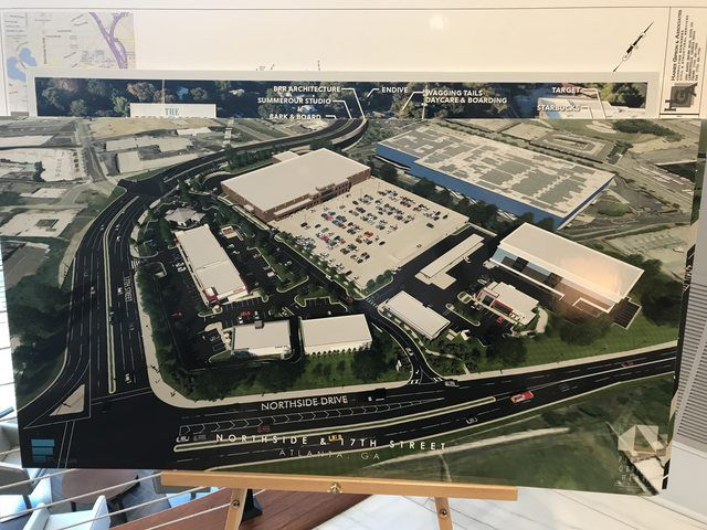 A photo of the image that shows lots of parking lots and big box stores.