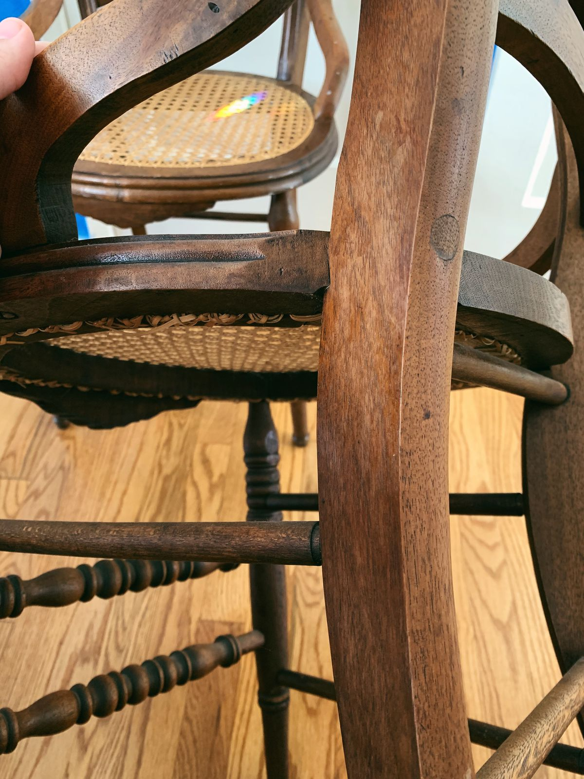A close-up of a wooden chair, where you can better see the joints that hold it together.
