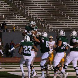 Johnnie Niupalau celebrating a touchdown