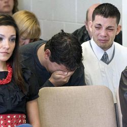 The sons of Victor Aguilar, Victor, 25, and Isaac, 20, are overcome with emotion as they listen to the testimony of their mother as she recounts the day she had to tell her family that their father was murdered. Thomas Noffsinger is serving a life sentence for Aguilar's murder and was charged Monday with a separate 1989 murder of a teenage girl.