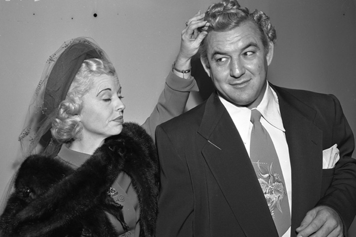 Gorgeous George Wagner with his wife Elizabeth (Betty) at court for name change in Los Angeles, Calif., 1950