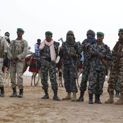 In this Feb. 7, 2011 photo, Malian soldiers stand guard during camel races in the northern town of Kidal, Mali. Since a March 21, 2012 military coup, ethnic Tuareg rebels have succeeded in taking the three largest towns in the Mali's north, Kidal, Gao and Timbuktu. On Friday, April 6, 2012, the same day that the junta declared they were stepping down, the rebels declared their independence. The loss of the northern half of the country, an area larger than France, has plunged Mali into crisis.