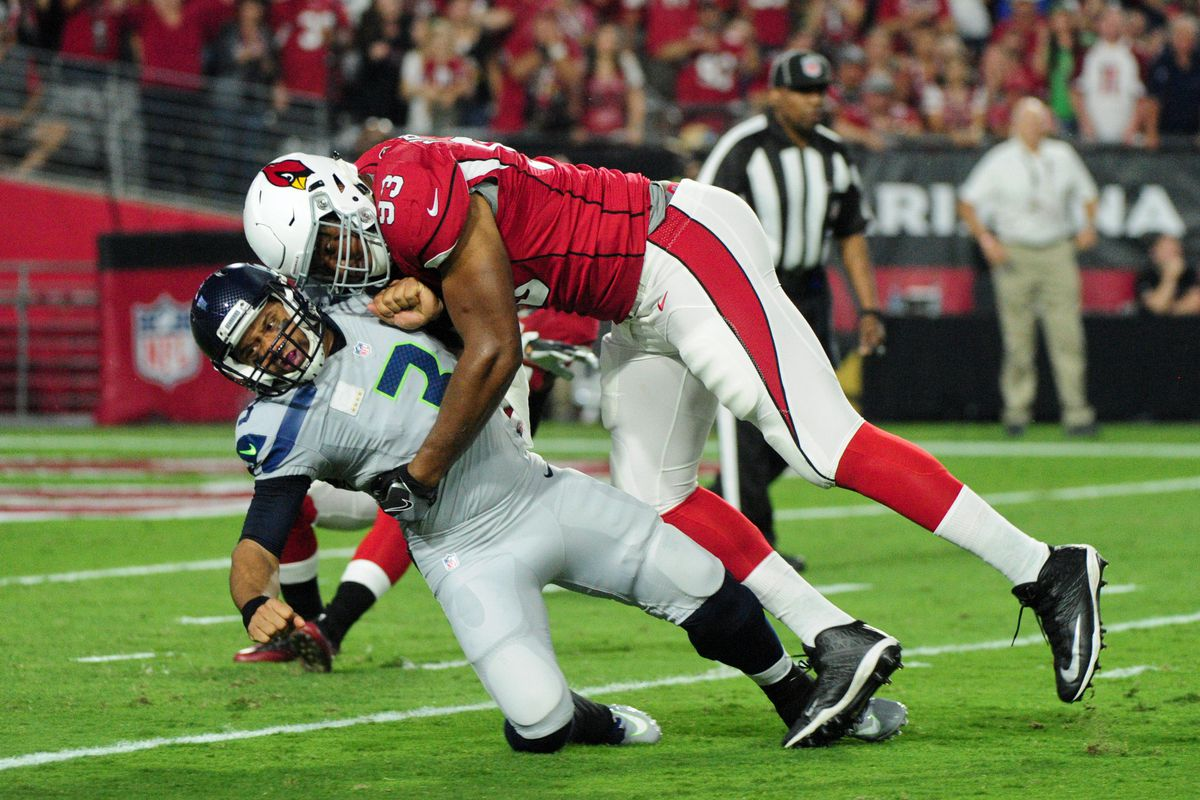 Was Russell Wilson trying to recruit Calais Campbell to the