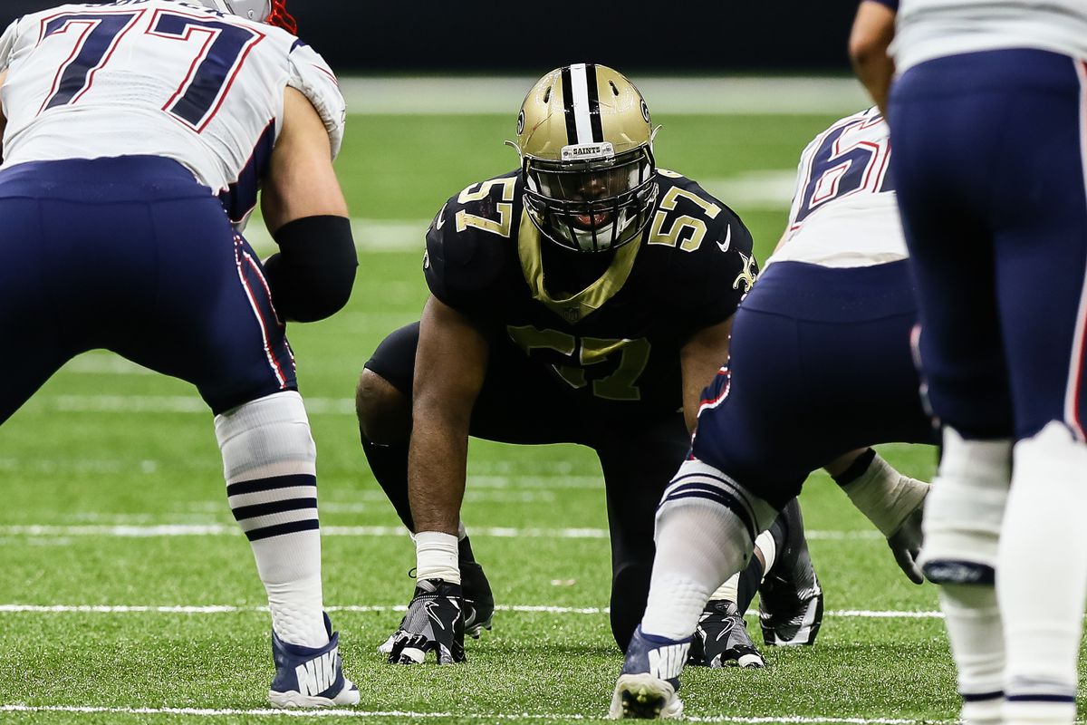 NEW ORLEANS, LA:  New Orleans Saints defensive end Alex Okafor (587) prepares to rush New England Patriots quarterback Tom Brady during a game at the Mercedes-Benz Superdome.