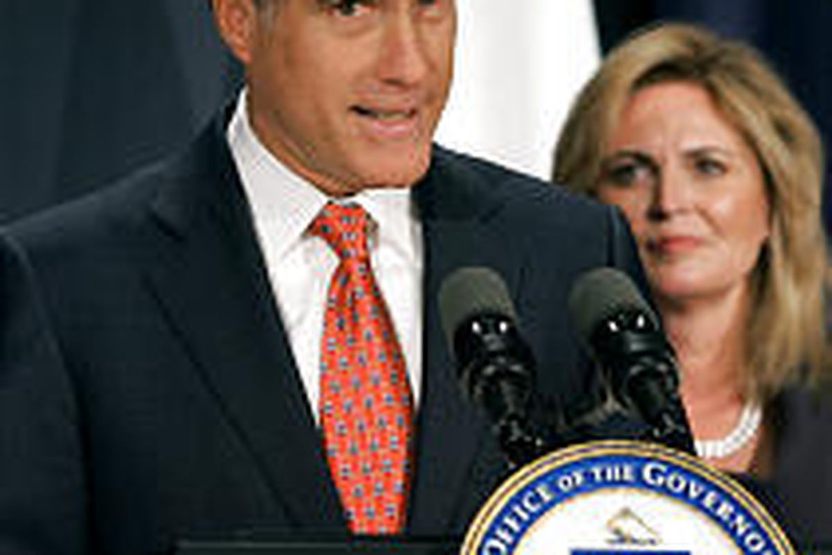 Gov. Mitt Romney is joined by his wife, Ann, as he announces that he will not seek re-election.