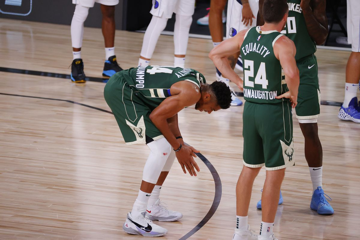 Giannis Antetokounmpo of the Milwaukee Bucks reacts after being fouled against the Dallas Mavericksat The Arena at ESPN Wide World Of Sports Complex on August 08, 2020 in Lake Buena Vista, Florida.