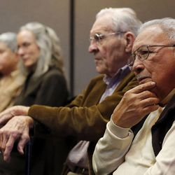 Archie Archuleta, front, listens as the Utah Citizens' Counsel announces its 2014 Assessment of Utah's Policy Progress in Salt Lake City, Wednesday, Dec. 10, 2014. Behind him is Boyer Jarvis.
