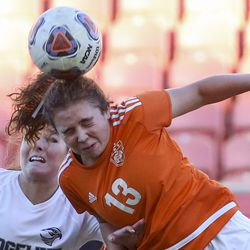 Ogden's Anabel Haaser (13) takes the header in front of Ridgeline forward Halle VanYperen (11) during the second half of the 4A girls state championship at Rio Tinto Stadium in Sandy on Friday, Oct. 25, 2019. Ogden defeated Ridgeline 2-1 in regulation time.