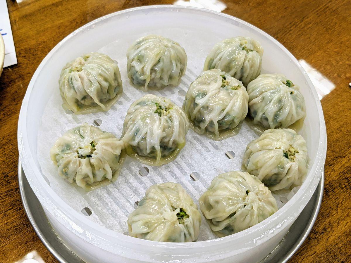 Pork dumplings from MDK Noodles in a white tray.