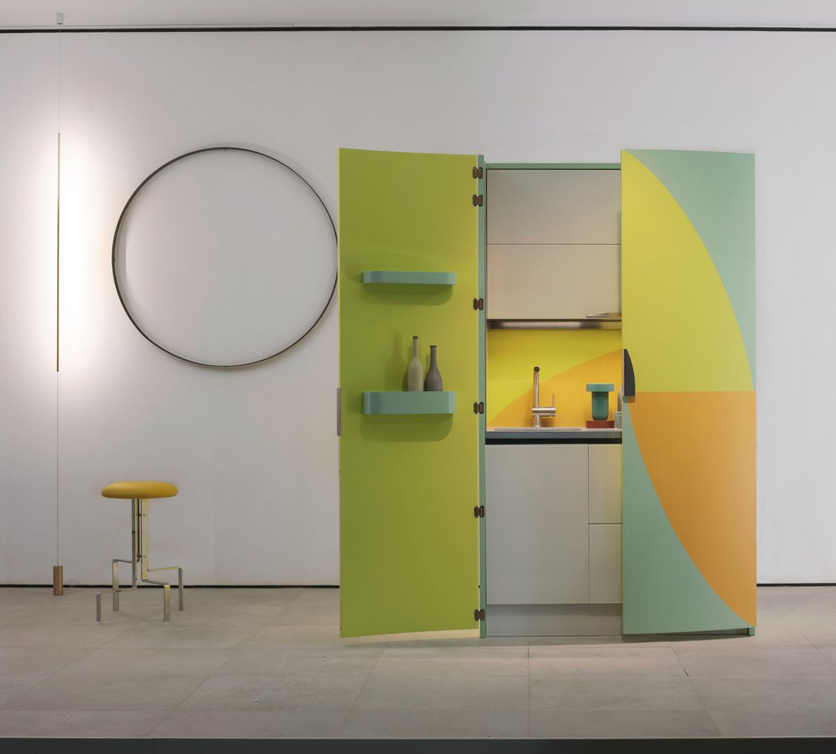 Colorful micro kitchen with one door open