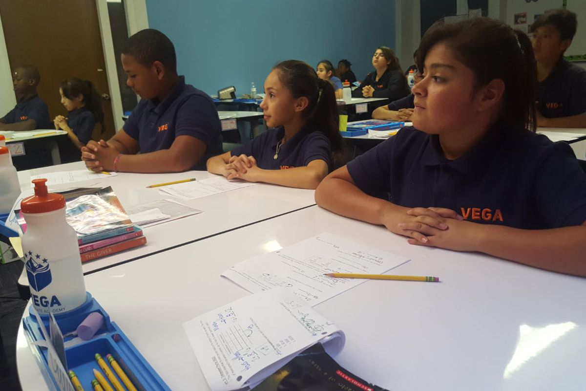 Sixth graders listen to a math lesson at Vega Collegiate Academy in Aurora during a September 2018 class. (Photo by Yesenia Robles, Chalkbeat)