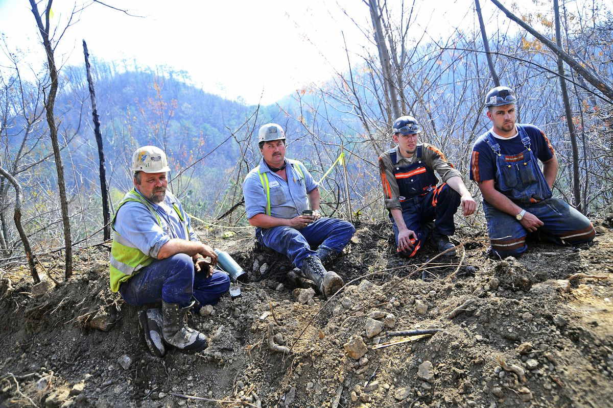 Massey Energy workers take a break from drilling efforts, April 7, 2010 in Montcoal, West Virginia, in an effort to release gas from the area where miners were believed to be trapped. The coal disaster ended up killed 29 people.