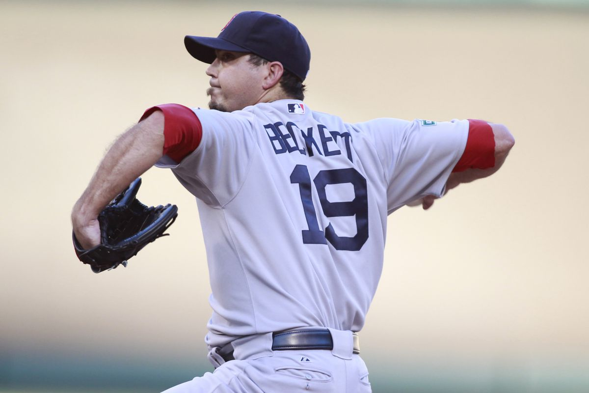 Jul 25, 2012; Arlington, TX, USA; Boston Red Sox starting pitcher Josh Beckett (19) throws a pitch during the first inning of the game against the Texas Rangers at Rangers Ballpark. Mandatory Credit: Tim Heitman-US PRESSWIRE