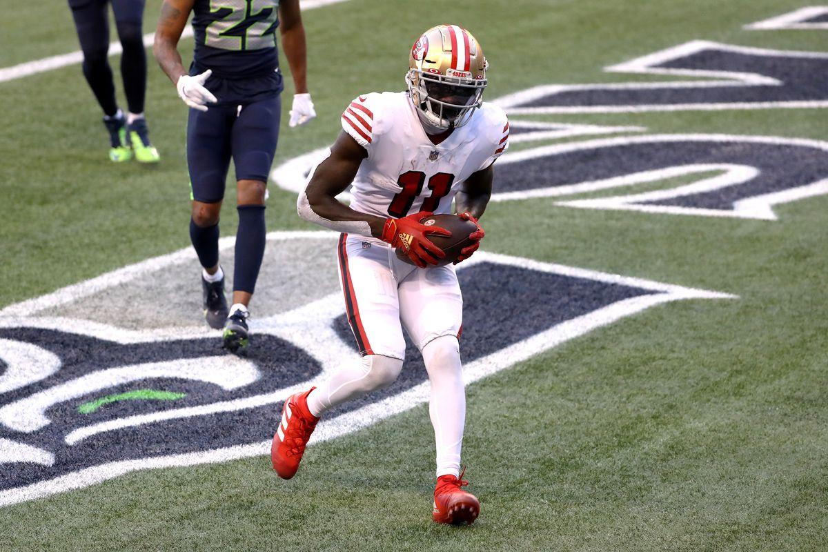 Brandon Aiyuk #11 of the San Francisco 49ers scores a touchdown in the fourth quarter against the Seattle Seahawks at CenturyLink Field on November 01, 2020 in Seattle, Washington.