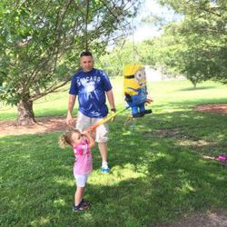 Illinois State Trooper Jerry Ellis watches his youngest daughter, Zoe, hit a piñata at a family reunion. | Provided